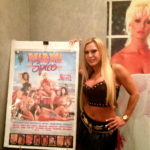 Amber with a marquee poster from her starring role in 1987's 'Miami Spice'